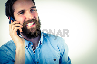 Handsome hipster making a call