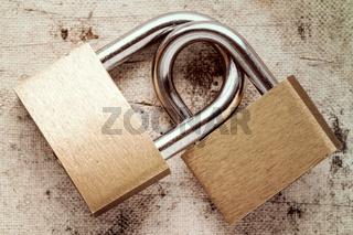 Two linked padlocks
