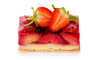 Fruitcake and strawberry isolated.