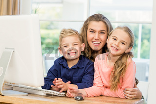 Happy family using the computer