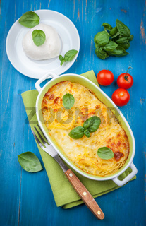 Casserole with pasta and mozzarella cheese with herbs