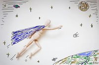 Superhero flying into space over the world. Abstract image with a wooden puppet