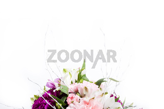 Bouquet from pink and purple gillyflowers with alstroemeria on white