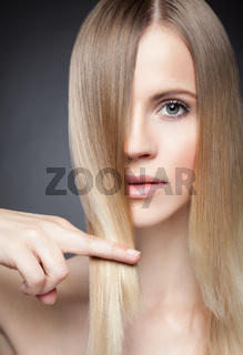 Beautiful young lady with straight hair
