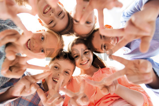 happy children showing peace hand sign
