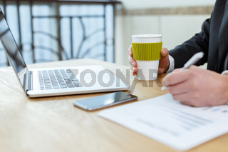 businessman checking financial reports