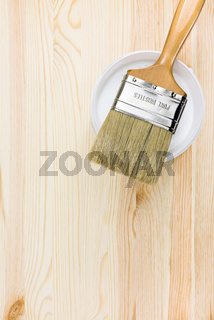 brush over can on wooden background