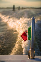 water trail from a motor boat in venice, italy