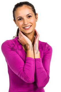 Smiling woman with hands on neck looking at the camera