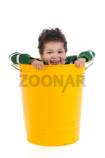Little boy in trash can