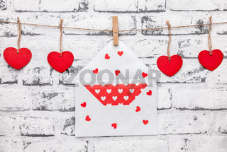 Love concept. Hearts and love letter hanging on a string