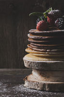 Breakfast in the wood : chocolate pancakes with strawberries, blackberries