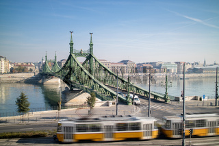 Liberty Bridge of Budapest with tram in the foreground