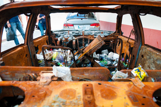 Wrecked Car With Garbage Inside
