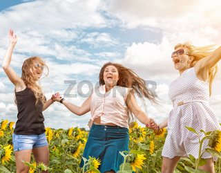 Group of friends having fun outdoors in a field