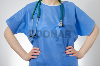 Closeup of confident female doctor in blue uniform