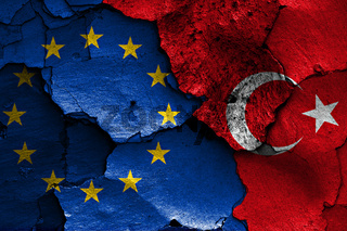 flags of EU and Turkey painted on cracked wall