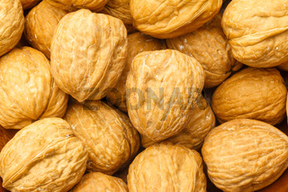 Close up pile of healthy walnuts. Studio shot from top.
