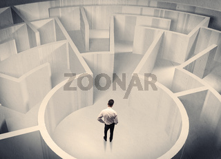 Business person standing in maze center
