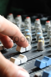Man adjusting audio mixer
