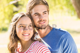 Cute couple hugging in the park