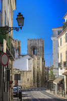 Lisbon city street with cathedral and railway