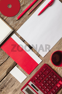 The mockup on wooden background with red calculator