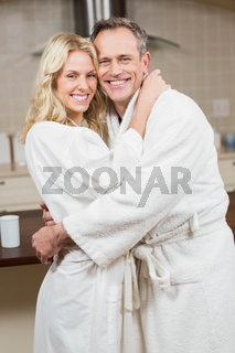 Cute couple hugging in bathrobes