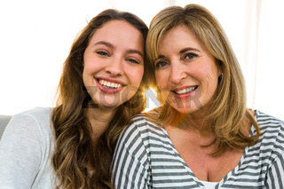Mother and daughter smiling