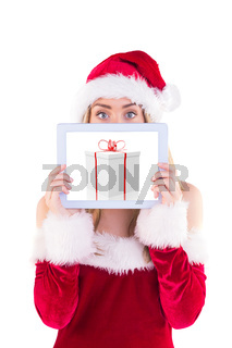 Composite image of pretty santa girl holding tablet