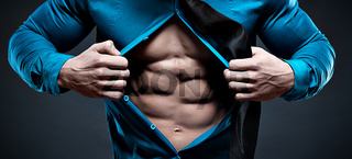 Young man displaying his abdominal muscles