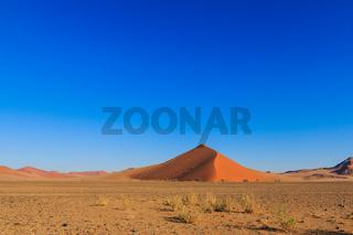 Blue sky above red sand dune landscape desert Sossusvlei