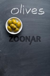 green olives on blackboard