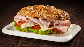 Ham sandwich on wooden background