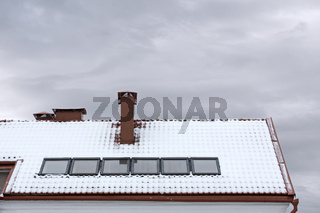 roof of house with skylights in snow