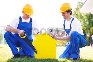 two workmen and house symbol