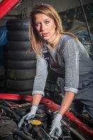 Female car mechanic in auto repair service