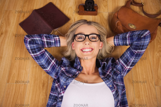 Gorgeous smiling blonde hipster lying