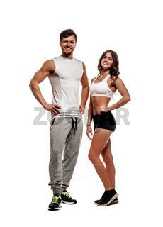 Young and beautiful athletic woman and man isolated on white background