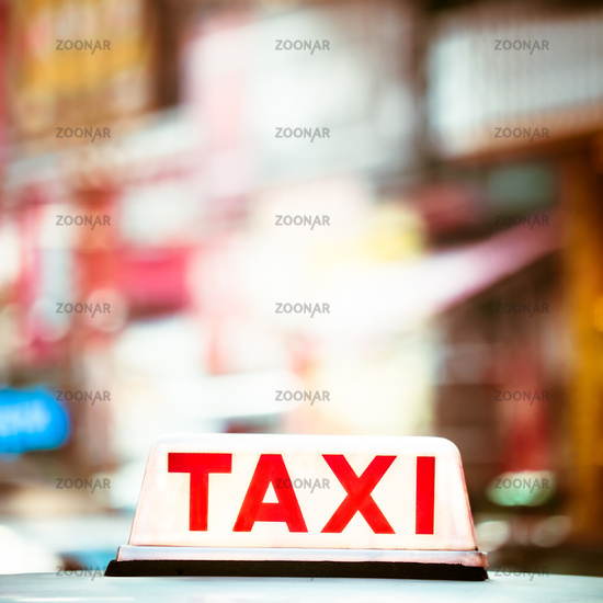 Abstract cityscape with taxi car at night city. Hong Kong