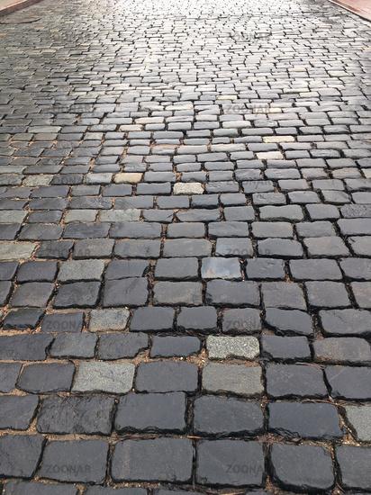 wet cobblestone street after rain
