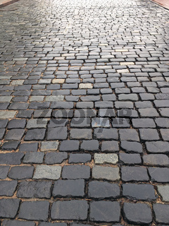 wet cobblestone street after rain