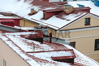 roofs of houses covered with snow