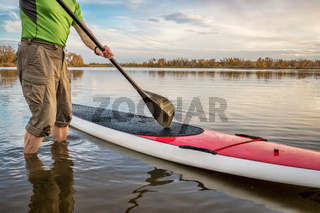 stand up paddleboard on lake