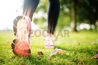 Highlighted foot bones of jogging woman