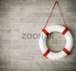 White and red lifebuoy at background