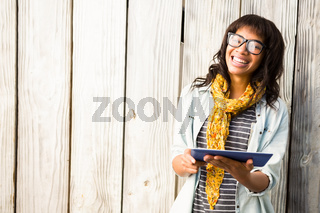 Casual smiling woman using tablet