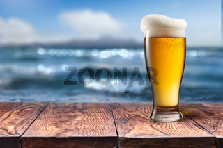 Empty wooden table with sea on background
