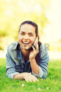 laughing young girl lying on grass