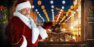 The man in costume of santa claus over  night city background